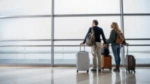 image of couple moving abroad in airport